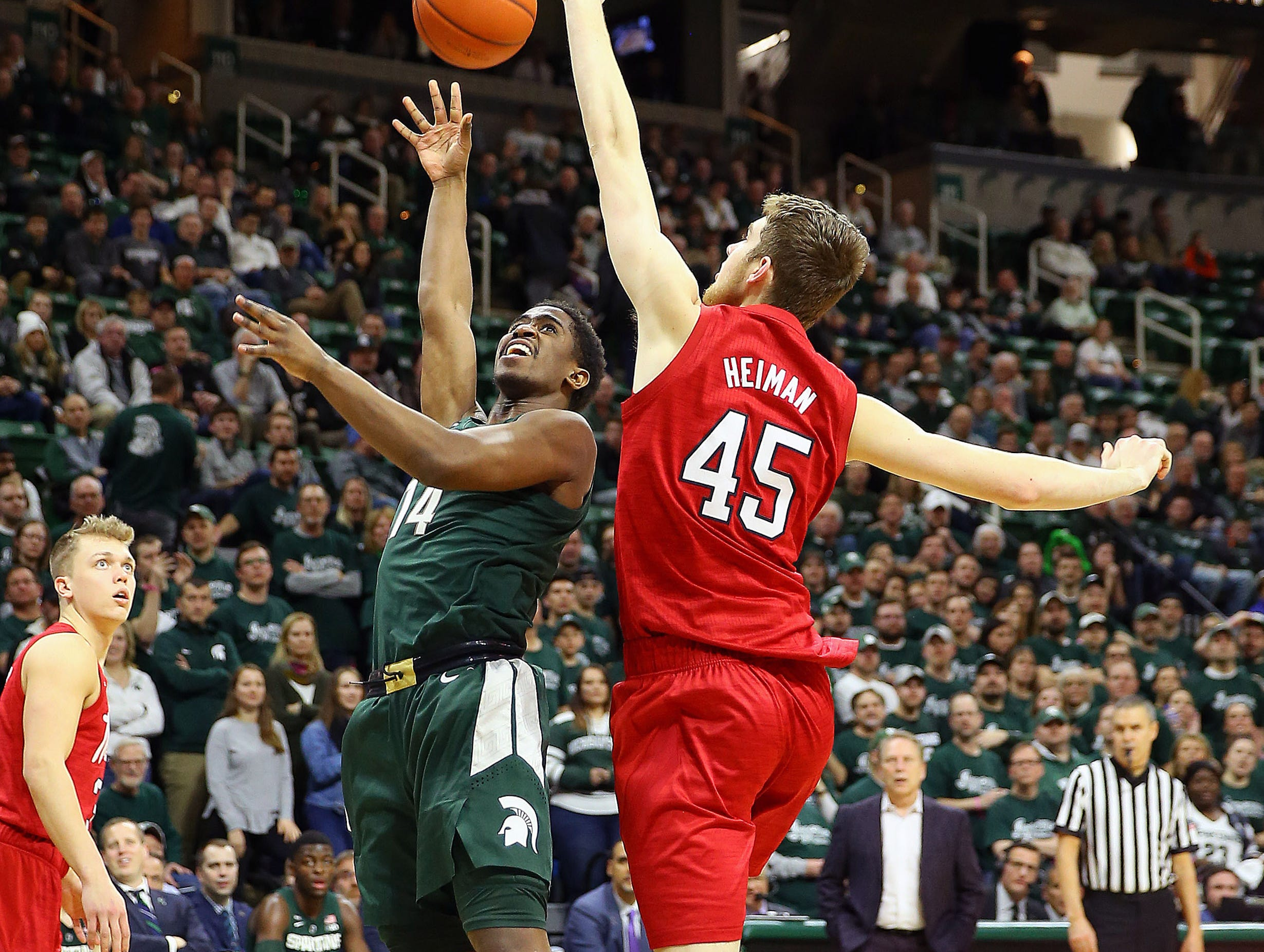 Mar 5, 2019; East Lansing, MI, USA; Michigan State Spartans guard Brock Washington (14) shoots the ball over Nebraska Cornhuskers forward Brady Heiman (45) during the second half at the Breslin Center. Mandatory Credit: Mike Carter-USA TODAY Sports