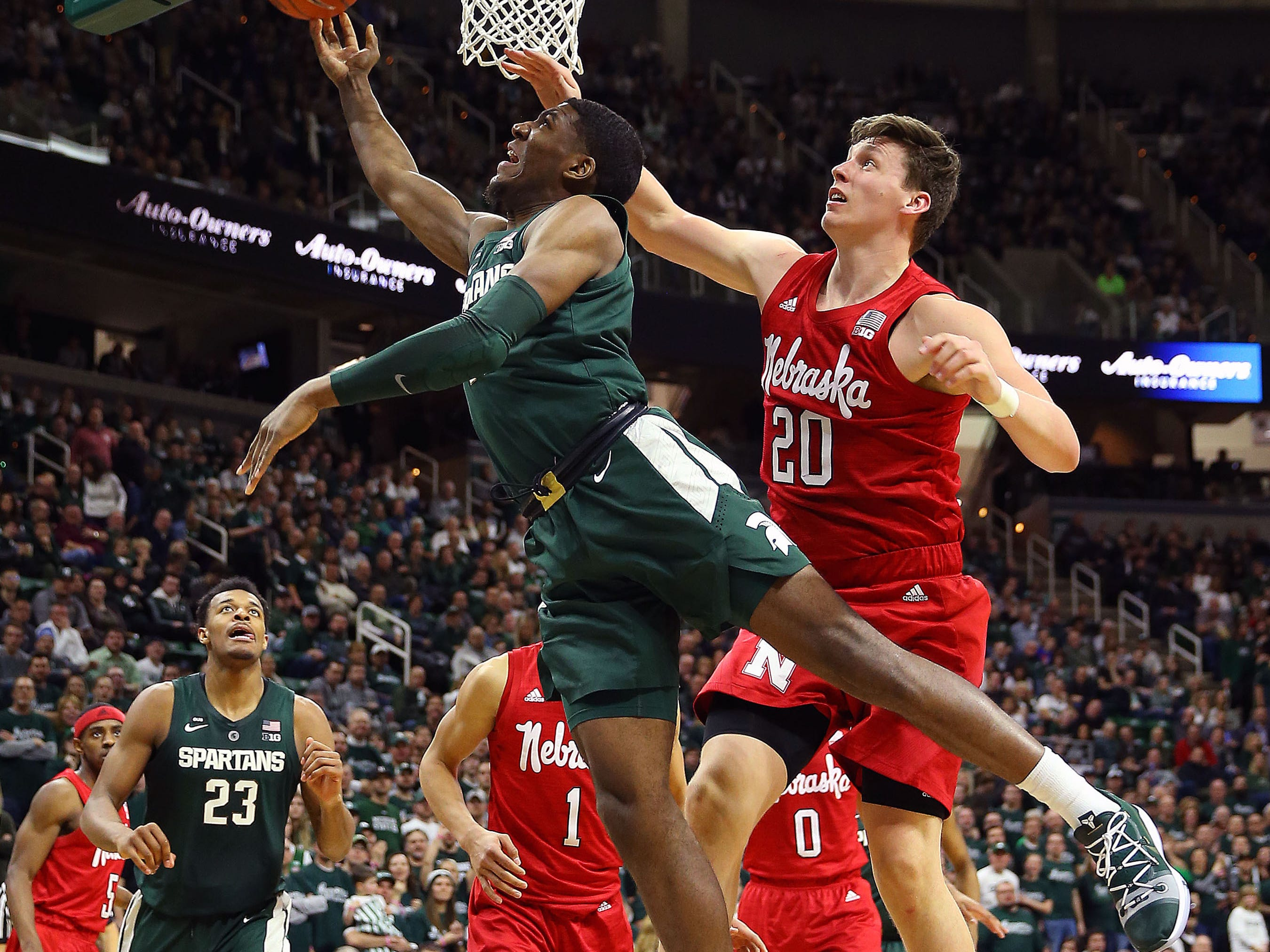 Mar 5, 2019; East Lansing, MI, USA; Michigan State Spartans forward Aaron Henry (11) drives to the basket against Nebraska Cornhuskers forward Tanner Borchardt (20) during the second half at the Breslin Center. Mandatory Credit: Mike Carter-USA TODAY Sports
