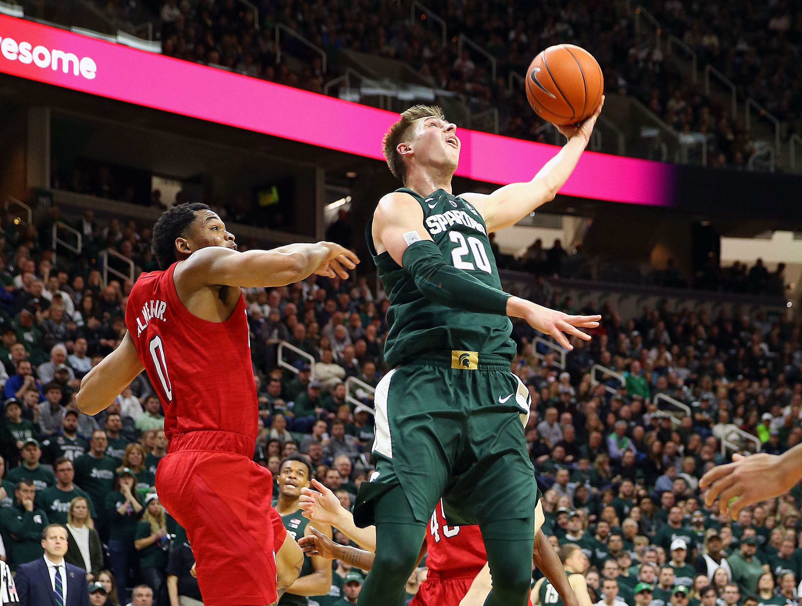 Mar 5, 2019; East Lansing, MI, USA; Michigan State Spartans guard Matt McQuaid (20) lays the ball up in front of Nebraska Cornhuskers guard James Palmer Jr. (0)  during the second half at the Breslin Center. Mandatory Credit: Mike Carter-USA TODAY Sports