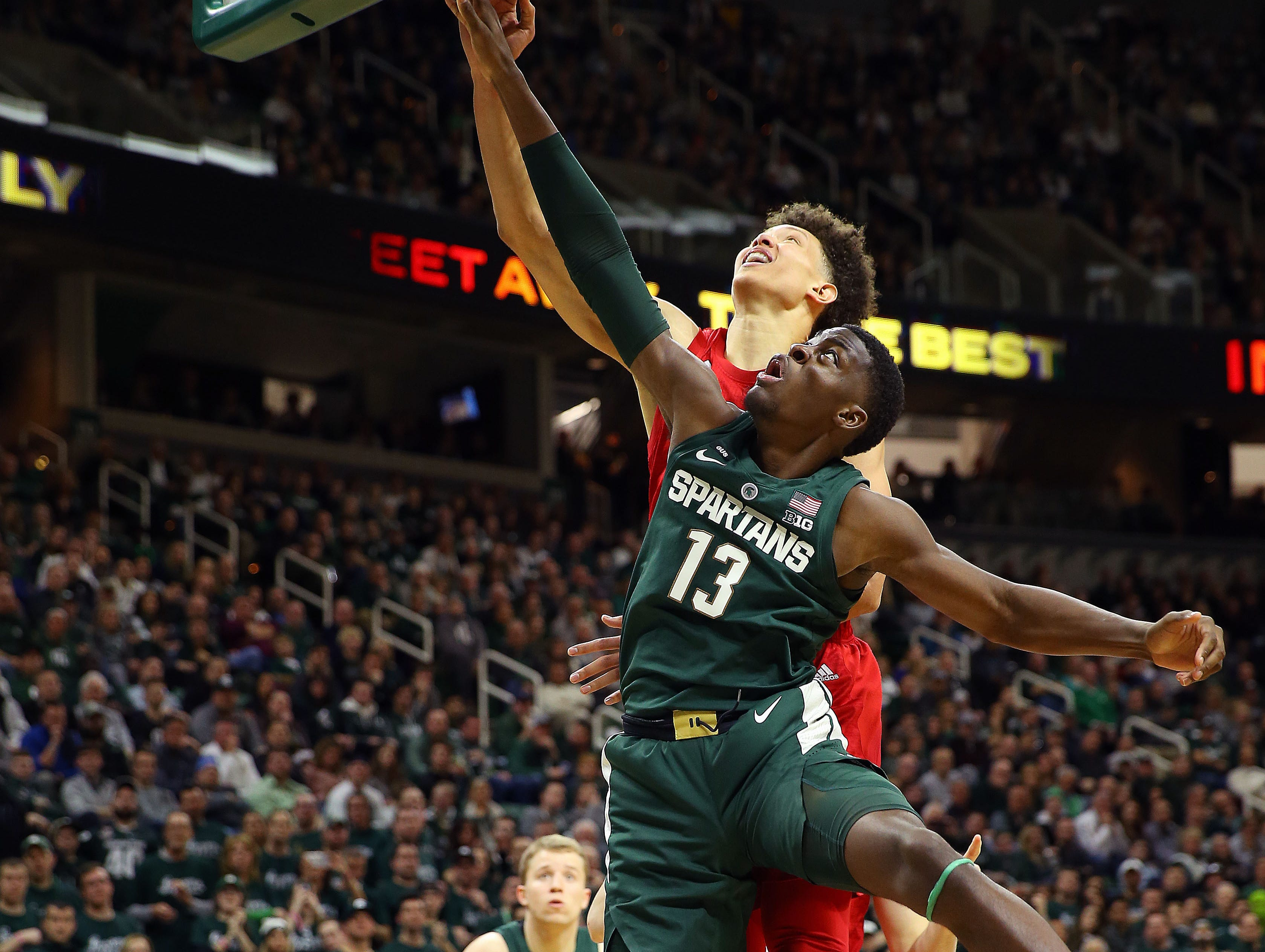 Mar 5, 2019; East Lansing, MI, USA; Michigan State Spartans forward Gabe Brown (13) lays the ball up in front of Nebraska Cornhuskers forward Isaiah Roby (15) during the second half at the Breslin Center. Mandatory Credit: Mike Carter-USA TODAY Sports
