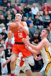 Lucas' Riley Gossom launches to the hoop past Colonel Crawford's Gavin Feichtner.