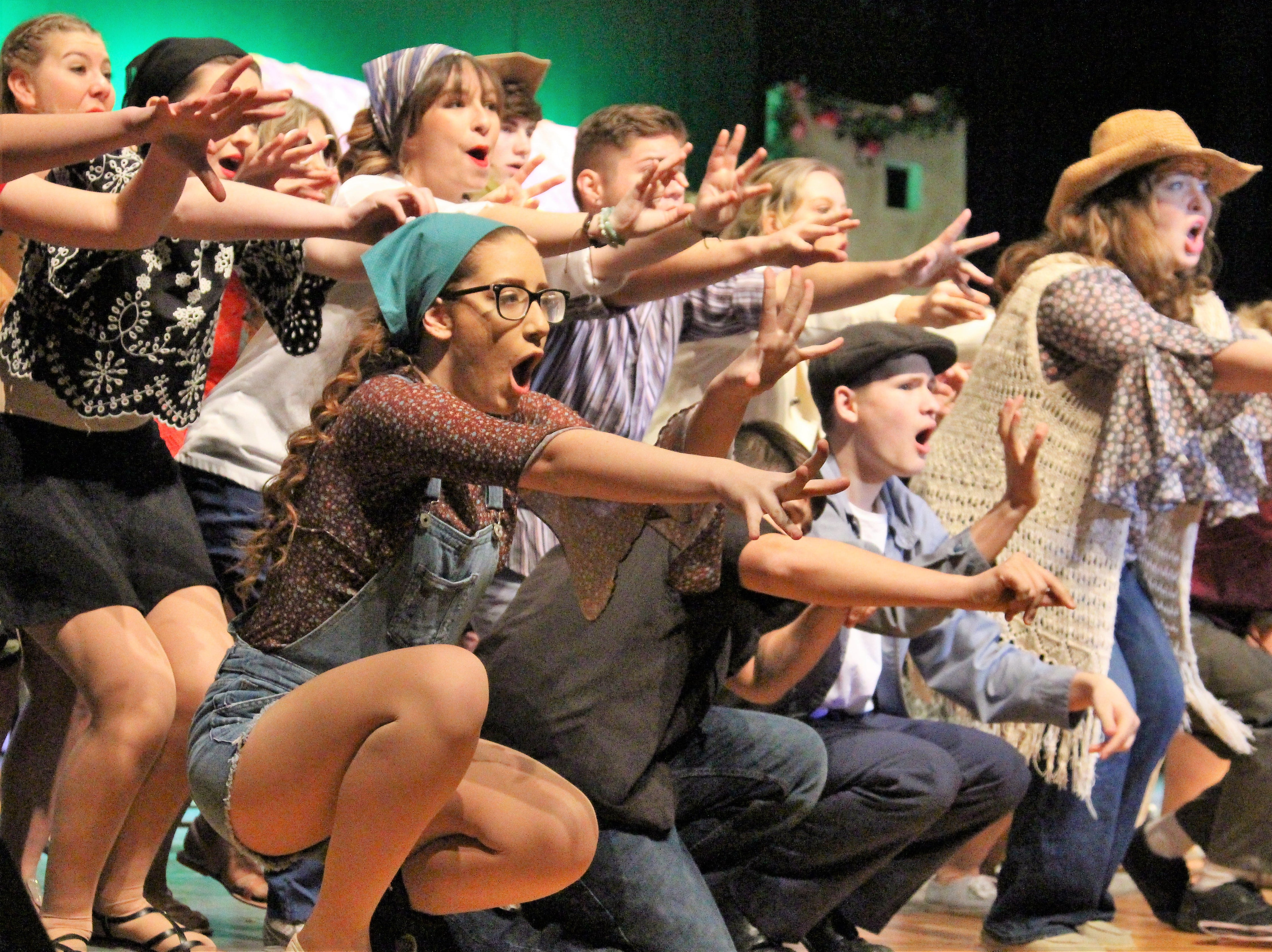 "Students reach out to the audience during a Tuesday evening rehearsal of  River Valley High School's production of ""Mamma Mia.""  The show will be held in the school's auditorium this weekend and general admission tickets are $11."