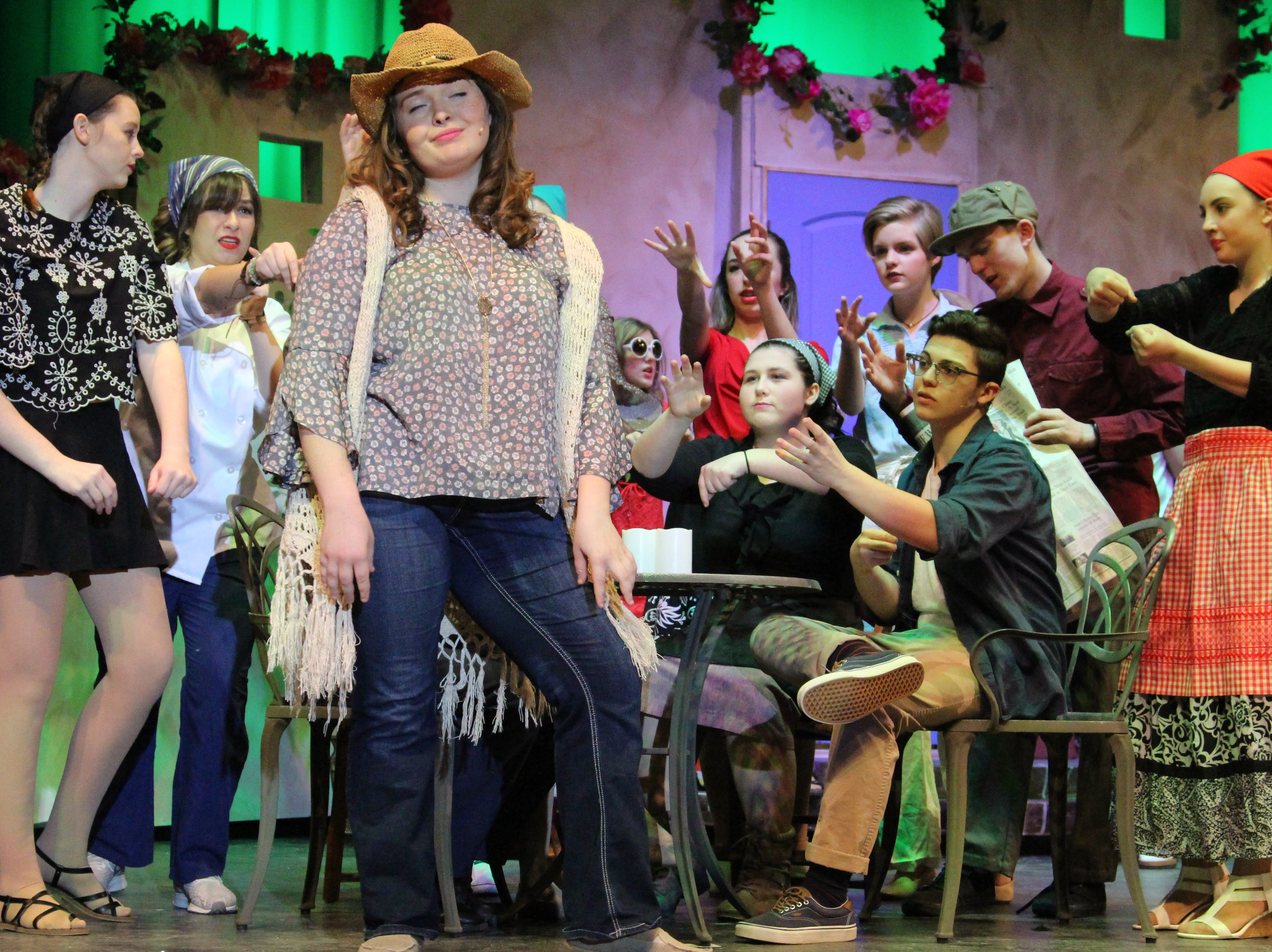 "Senior Shea Edler takes the stage as Donna Sheridan —who is reacquainted with three of her ex-lovers on the eve of her daughter's wedding— during River Valley's production of the jukebox musical ""Mamma Mia."""