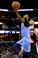 Memphis Grizzlies guard Mike Conley shoots ahead of Portland Trail Blazers center Jusuf Nurkic (27) in the first half of an NBA basketball game, Tuesday, March 5, 2019, in Memphis, Tenn. (AP Photo/Brandon Dill)