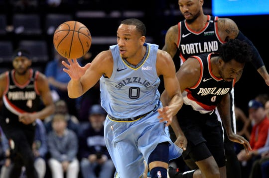 Memphis Grizzlies guard Avery Bradley (0) brings the ball up the court ahead of the Portland Trail Blazers defense in the first half of an NBA basketball game, Tuesday, March 5, 2019, in Memphis, Tenn. (AP Photo/Brandon Dill)
