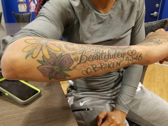 "Memphis women's basketball player Ashia Jones shows the ""Beautifully Broken"" tattoo that reminds her of the loved ones she lost to murder and drug overdose."