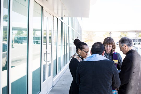 From left, the Rev. Ayanna Watkins, Minister Johan Daza, the Rev. Lucy Waechter Webb and Monsignor Val Handwerker say a prayer before offering to place ashes on the heads of migrants traveling through Memphis on Ash Wednesday at the Greyhound bus station.