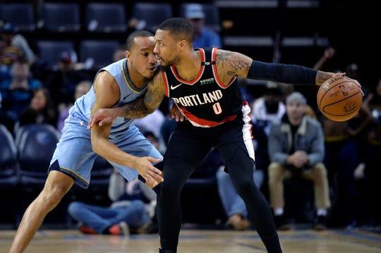 Portland Trail Blazers guard Damian Lillard (0) handles the ball against Memphis Grizzlies guard Avery Bradley in the first half of an NBA basketball game, Tuesday, March 5, 2019, in Memphis, Tenn. (AP Photo/Brandon Dill)