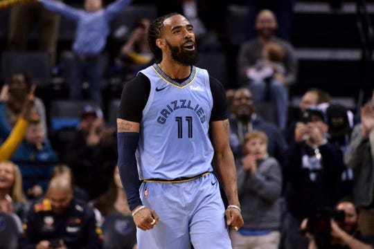 Memphis Grizzlies guard Mike Conley reacts during the second half of the team's NBA basketball game against the Portland Trail Blazers on Tuesday, March 5, 2019, in Memphis, Tenn. (AP Photo/Brandon Dill)