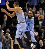 Memphis Grizzlies guards Mike Conley (11) and Avery Bradley (0) celebrate during the second half of the team's NBA basketball game against the Portland Trail Blazers on Tuesday, March 5, 2019, in Memphis, Tenn. (AP Photo/Brandon Dill)