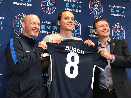 Memphis 901 FC coach Tim Mulqueen, left, and president Craig Unger, right, pose with captain Marc Burch during his introductory press conference in February.