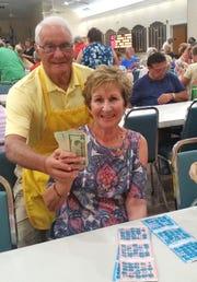 Big winner Arlene Krofel with JCMI Bingo committee member Joe Atkin.