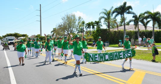 The Newcomers march in the parade.
