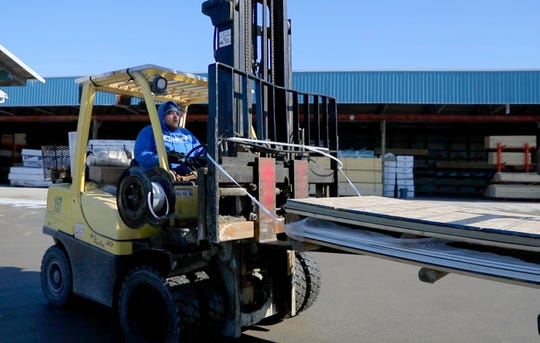 Drexel Building Supply Inc. operational team member Josh Fell works on a fork lift in the lumber yard at Drexel Building Supply Inc.