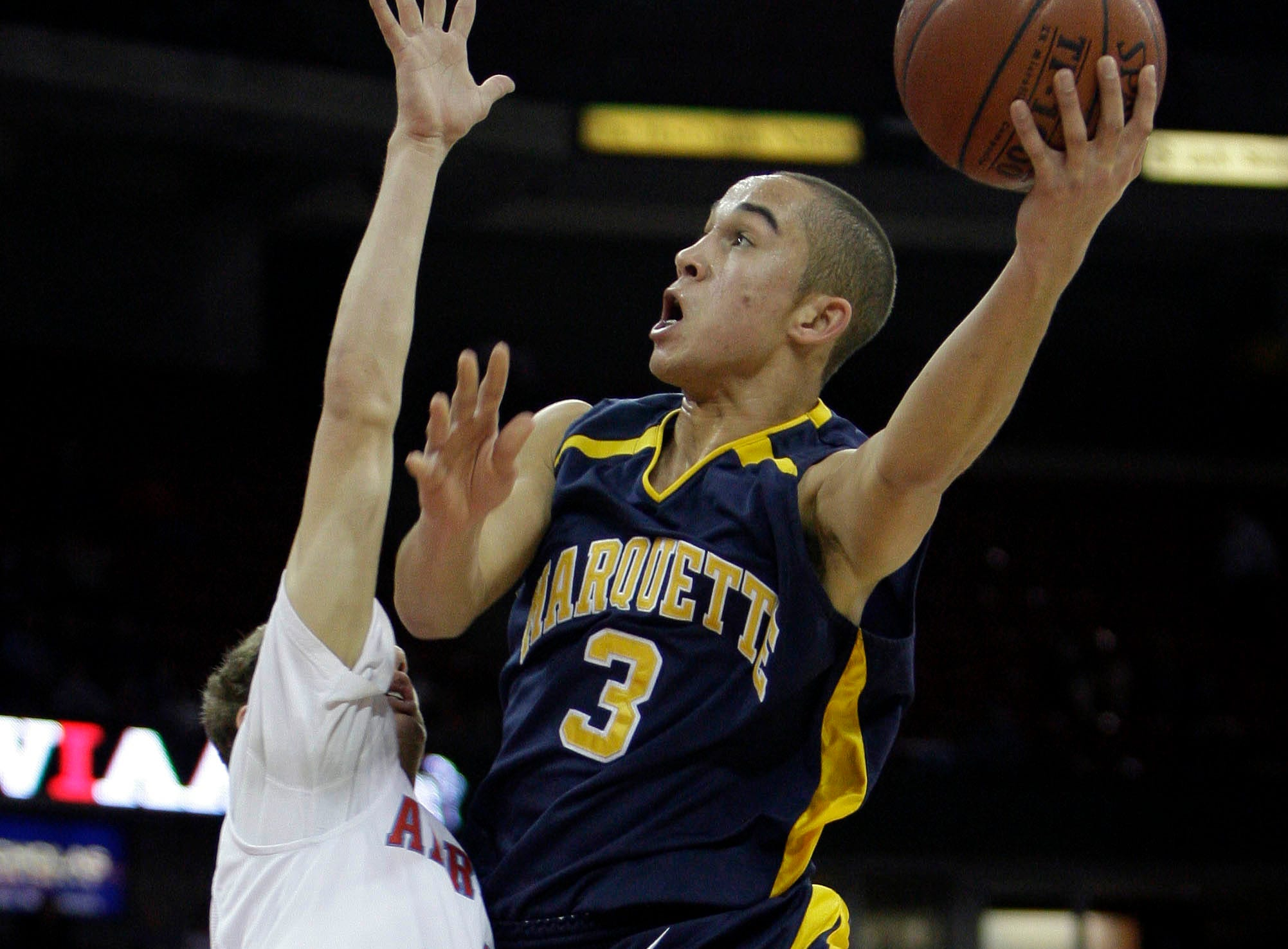 Marquette's Quinten Calloway makes a shot over Arrowhead's Andy Fox during the first half of their semifinal game Friday, March 19, 2010 during the WIAA state tournament at the Kohl Center in Madison, Wis.