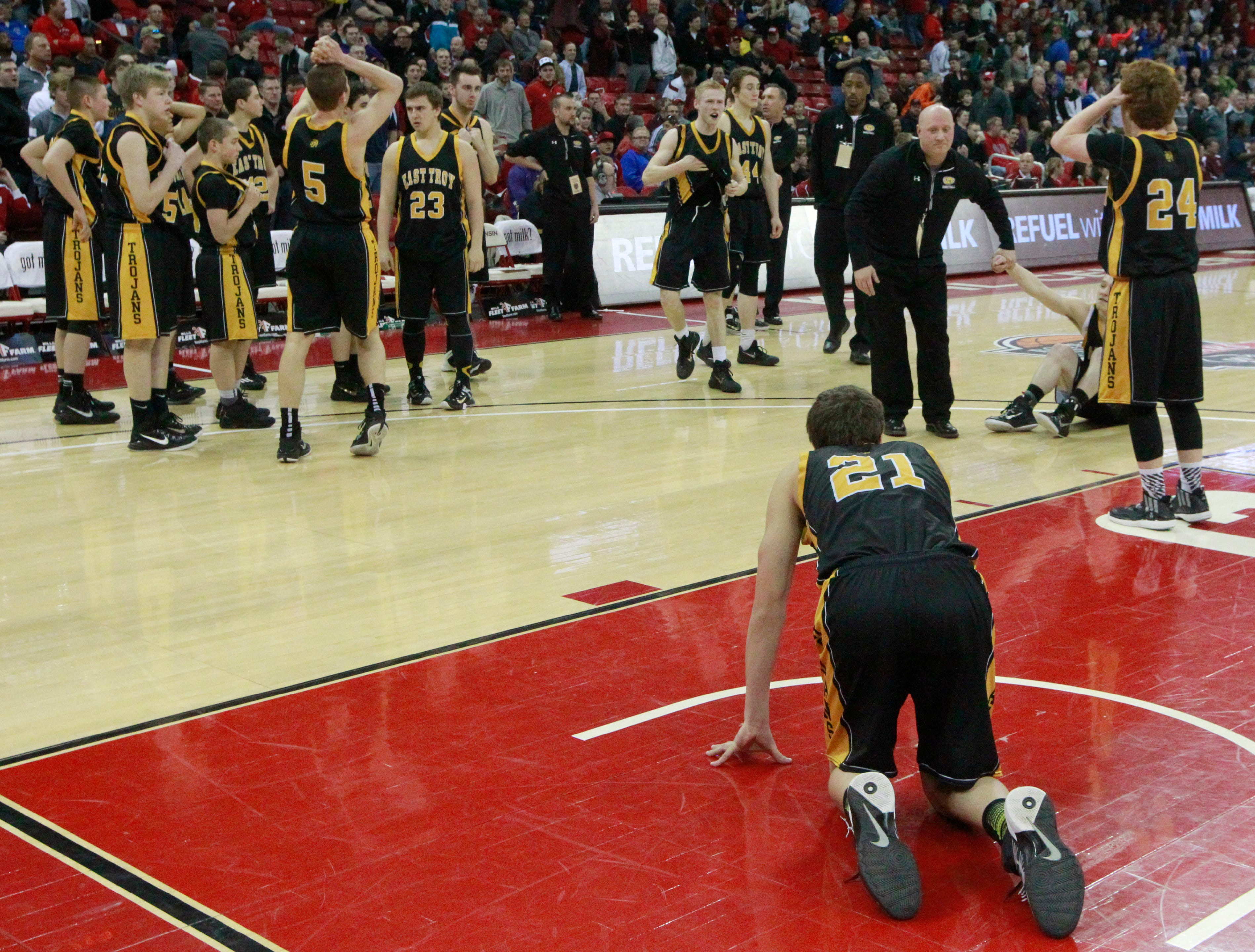 East Troy players reacts after their division 3 semifinal game at the WIAA State Boys Basketball Tournament Friday, March 20, 2015 at the Kohl Center in Madison, Wis. Appleton Xavier beat East Troy 70-69.