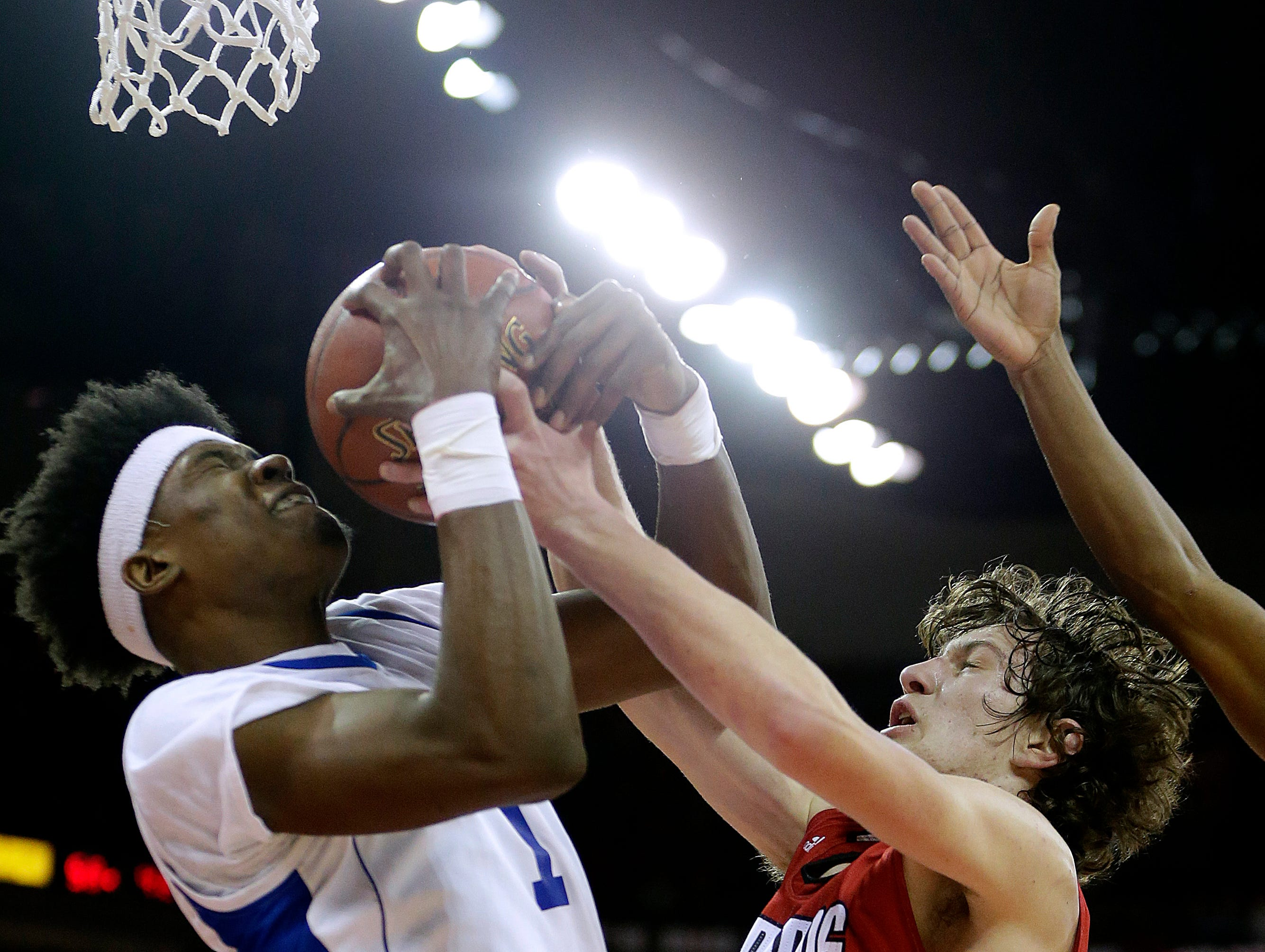 Destiny's Terrance Banyard (1) controls a rebound against Darlington's Will Schwartz (1) during Destiny's 76-55 win over Darlington to win the Division 4 Championship at the WIAA boys' state basketball championships Saturday, March 18, 2017, in Madison, Wis. Milwaukee Journal Sentinel photo by Rick Wood/RWOOD@JOURNALSENTINEL.COM    ORG XMIT: 20091664A