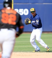 Tyler Saladino has started three games at short, one at second base, one at first base and made his outfield debut Tuesday in Brewers camp.