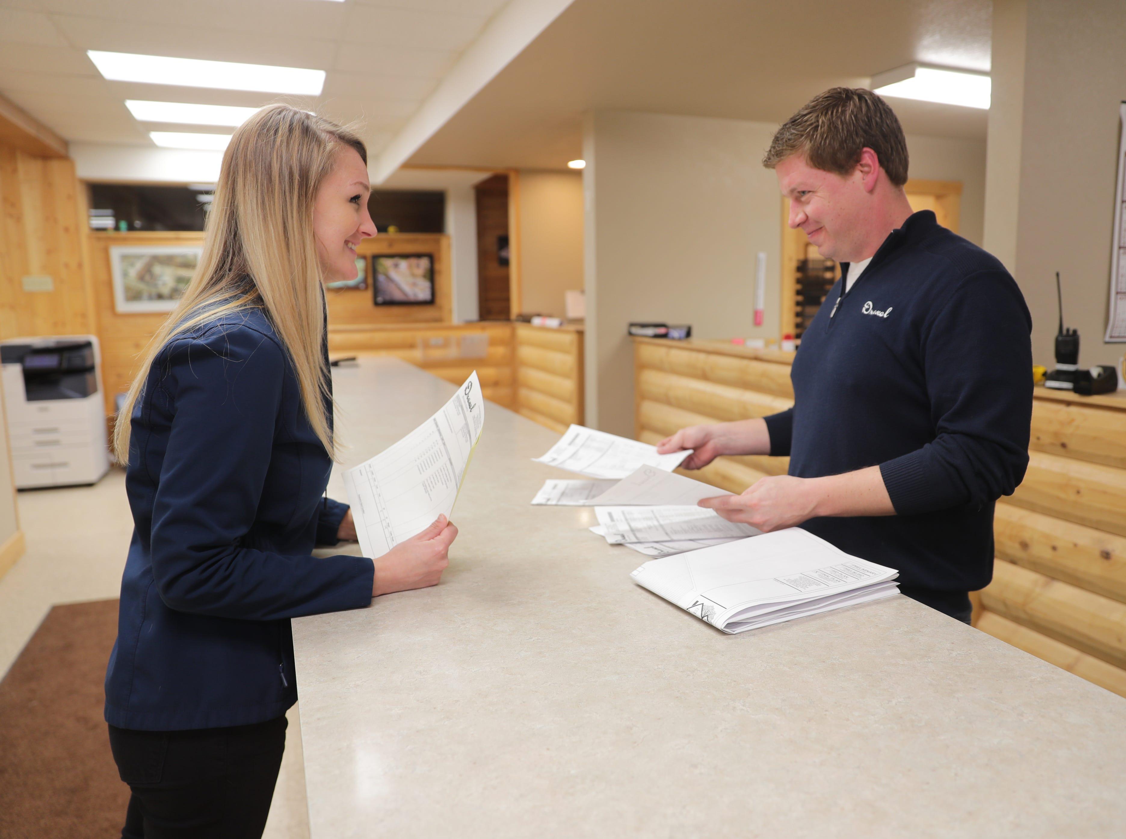 Drexel Building Supply Inc. Sales Director Julie Schmitz and Account Manager Tim Mulder go over orders March 5 at Drexel Building Supply Inc. in Campbellsport.