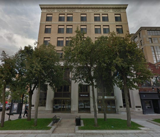 It appears that Foxconn will announce Friday that it is buying this six-story office building in downtown Madison for another of what the company is calling its innovation centers.