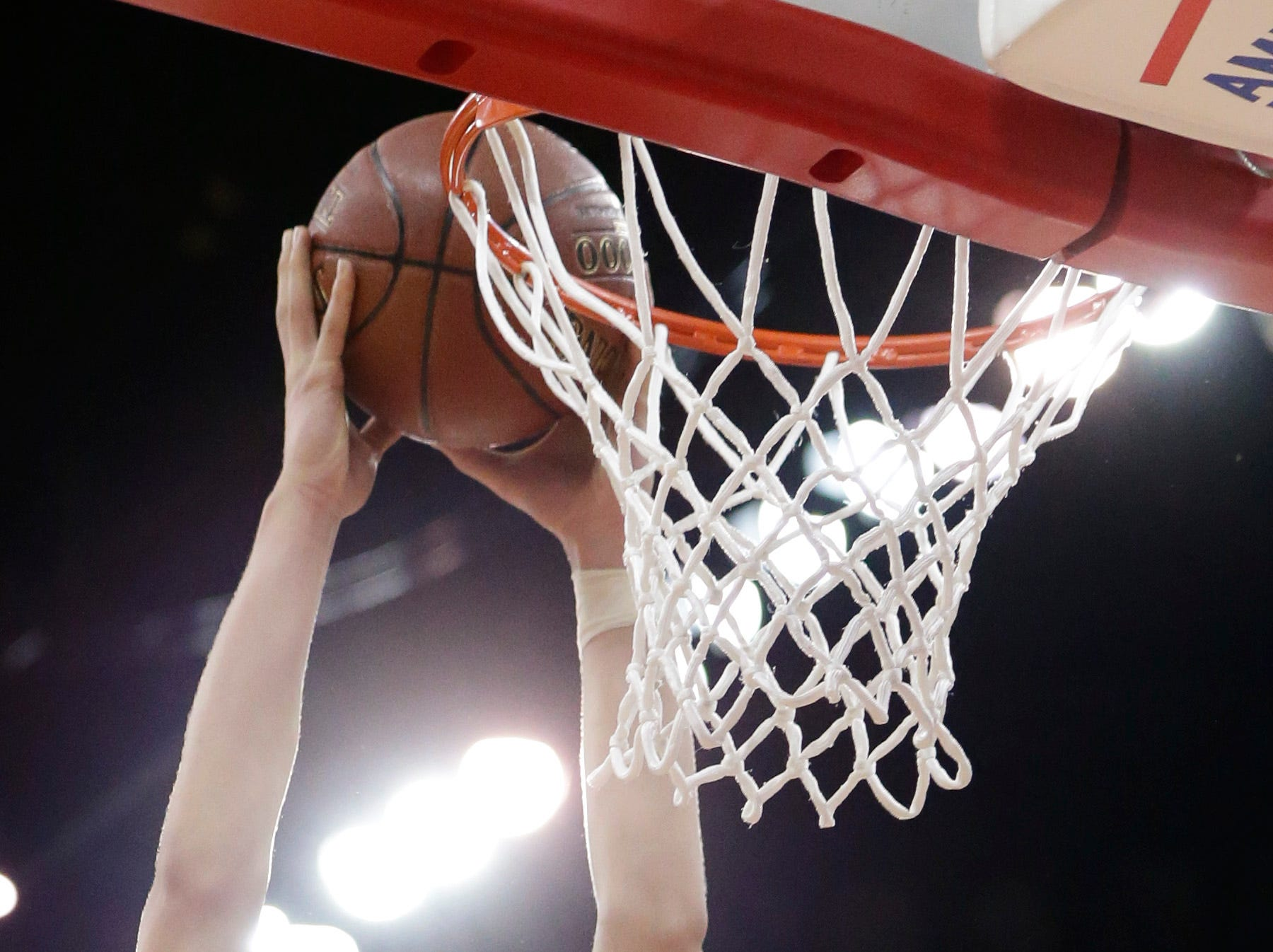 Brown Deer's Taurus Adams II dunks the ball during the second half of their division 3 semifinal game at the WIAA State Boys Basketball Tournament Friday, March 20, 2015 at the Kohl Center in Madison, Wis. Brown Deer beat Prescott 62-50.  MARK HOFFMAN/MHOFFMAN@JOURNALSENTINEL.COM