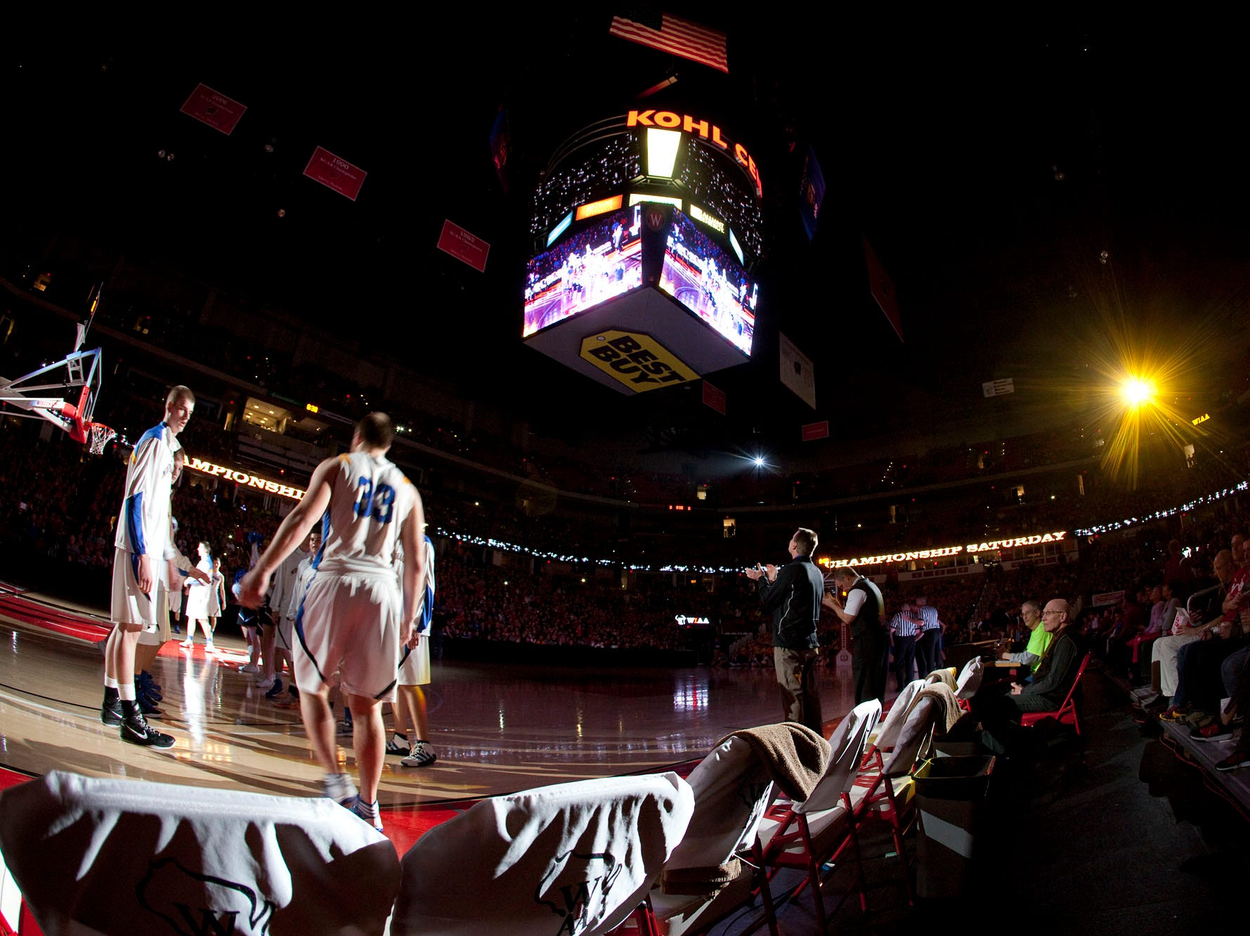 Mukwonago players are introduced before the start of the teams W.I.A.A. Division 1 Boys State Basketball Tournament Championship game against Germantown in the Kohl Center Saturday, March 9, 2013, in Madison, Wis.