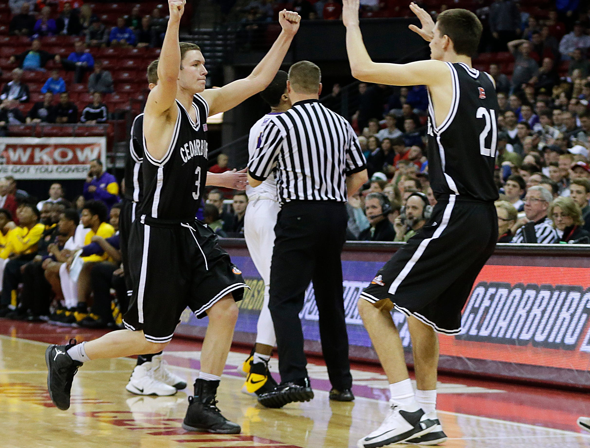 Cedarburg's  John Diener (3) celebrates with teammates including Matthew Barber (21)  after Cedarburg's 73-70  overtime victory over Milwaukee Washington. Diener set a state record scoring 46 points  during the Division 2 semifinal between Cedarburg and Milwaukee Washington at the WIAA boys' state basketball championships Friday, March 17, 2017, in Madison, Wis. (Milwaukee Journal Sentinel photo by Rick Wood/RWOOD@JOURNALSENTINEL.COM    ORG XMIT: 20091658A