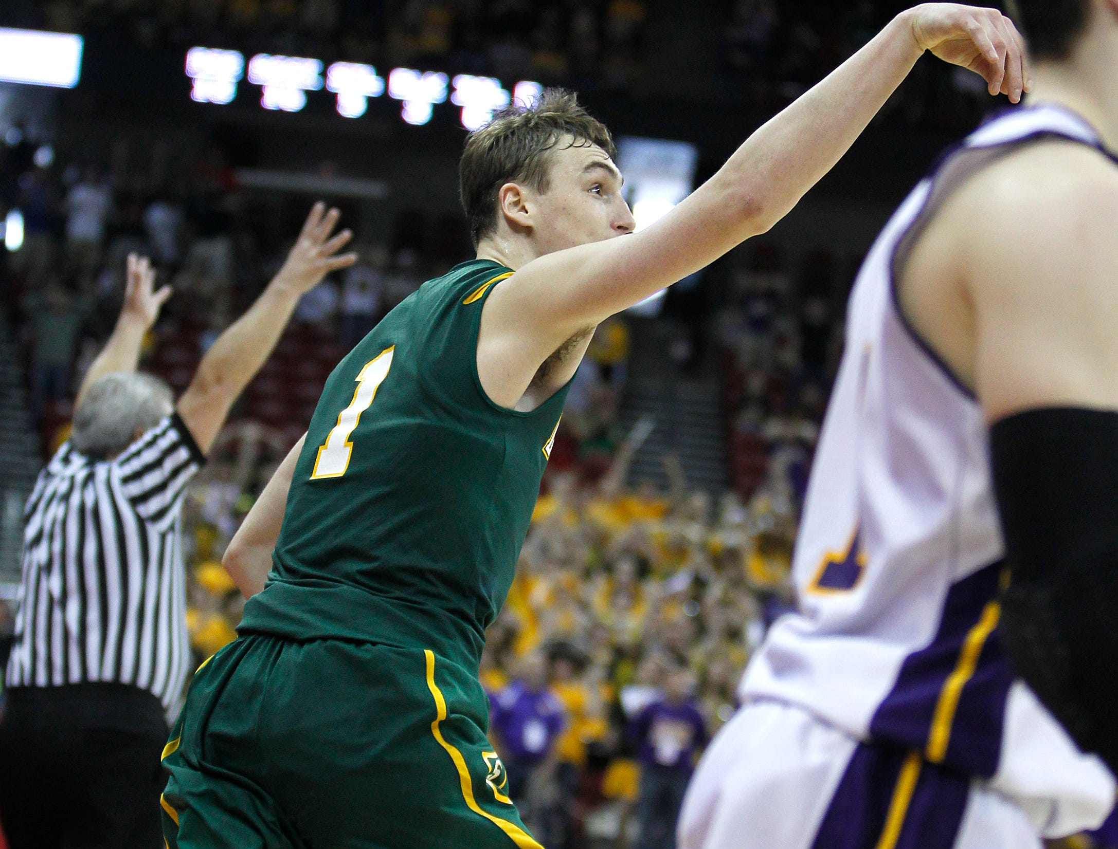 Sheboygan Area Lutheran's Sam Dekker follows through with a three pointer at the buzzer to defeat Racine Lutheran for the 2012 Division 5 Wisconsin state championship at the Kohl Center.