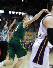 Sam Dekker follows through on a three-pointer at the buzzer to defeat Racine Lutheran for the 2012 Division 5 title.