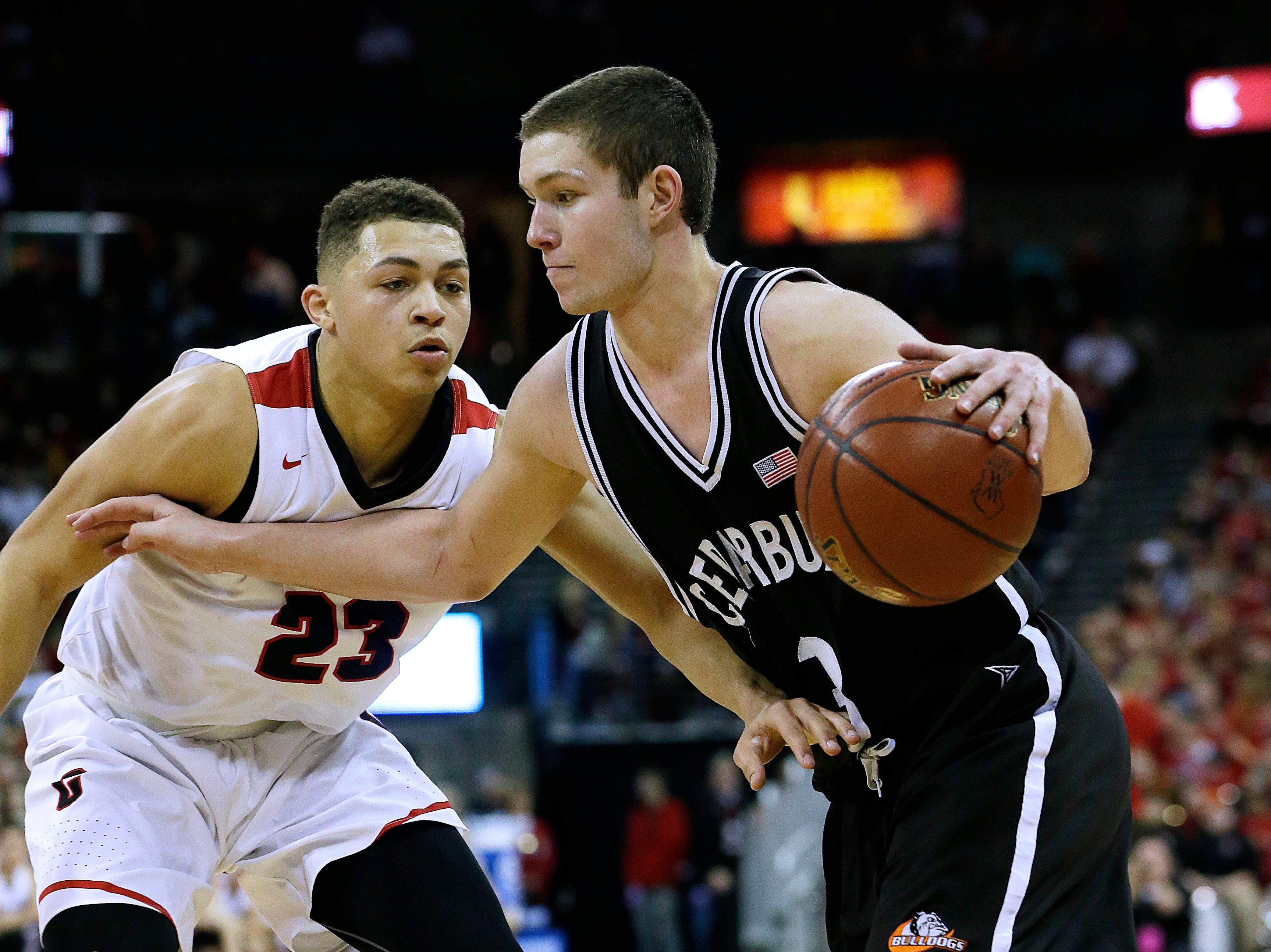 Cedarburg's John Diener (3) drives against La Crosse's Kobe King (23) during La Crosse's 55-53 win over Cedarburg in the Division 2 Championship  game b at the WIAA boys' state basketball championships Saturday, March 18, 2017, in Madison.