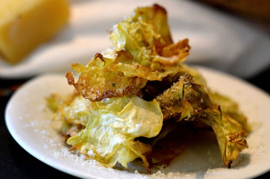 Crispy Parmesan cabbage chips can be eaten as is or served with dip.