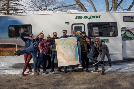 Right after the dart toss determined the destination, the nine friends from the Milwaukee area boarded a rented RV in Wauwatosa and headed to Jump River, Wisconsin. They are Scott Gerdzunas (from left), Dasan Cook, Chad Carroll, David Weideman, Chris Braun, Andrew Mente, Joe O'Keeffe, Eric Purdue and Jim Kennelly.