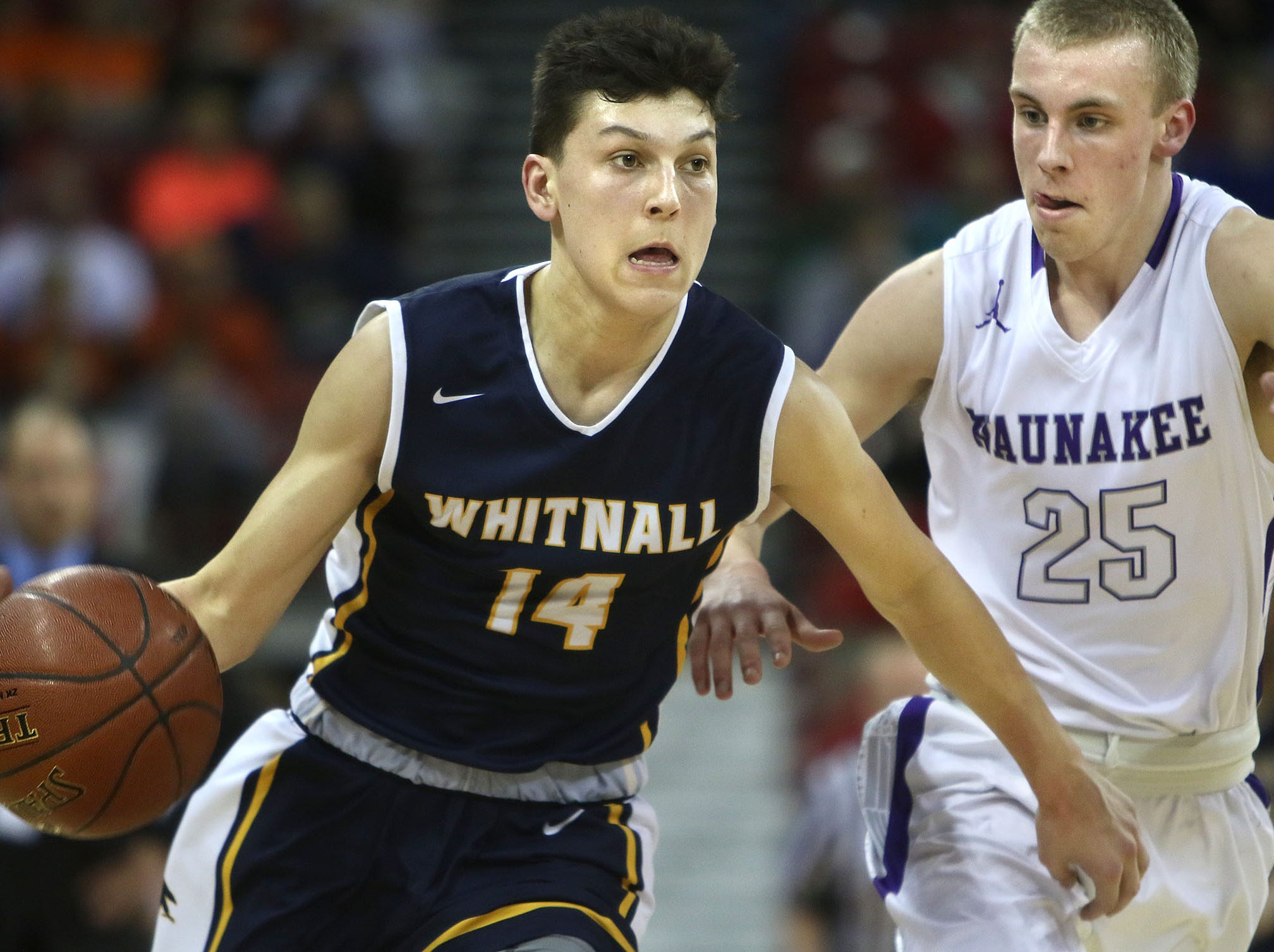 Whitnall's Tyler Herro (14) drives past  Waunakee's Mason Steffen (25) during the teams W.I.A.A. Boys State Basketball Tournament semi-final game in the Kohl Center Friday, March 18, 2016, in Madison, Wisconsin. Waunakee won the game 62-59.