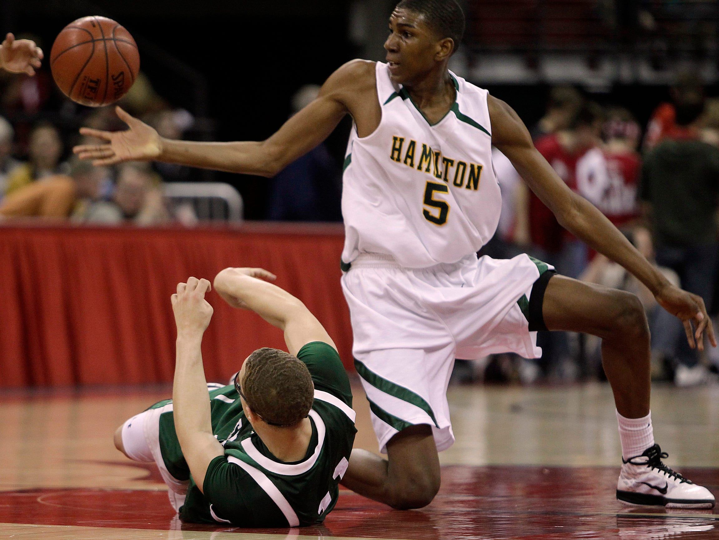 Milwaukee Hamilton's Kevon Looney and Madison Memorial's Miles Chamberlain fight for a loose ball during the WIAA state basketball tournament at the Kohl Center Friday, March 18, 2011.