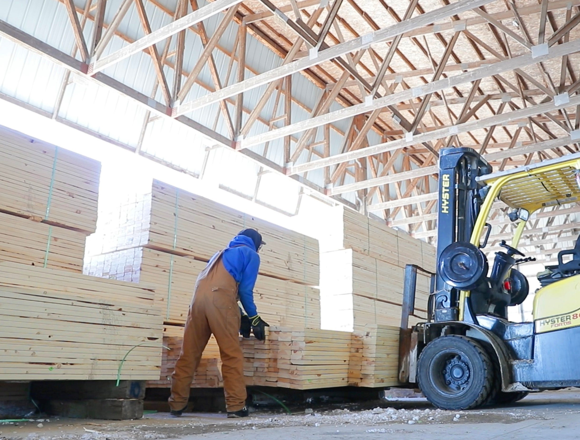 Drexel Building Supply Inc. operational team member Dylan Horning works in the lumber yard at Drexel Building Supply Inc. in Campbellsport.