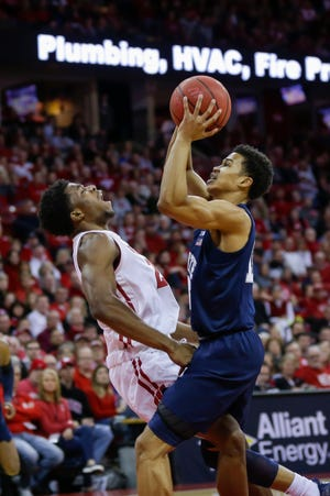 The defense of Wisconsin's Khalil Iverson (left), shown here drawing a foul on Penn State's Rasir Bolton on Saturday, has become a strength for the Badgers, especially in late-game situations.