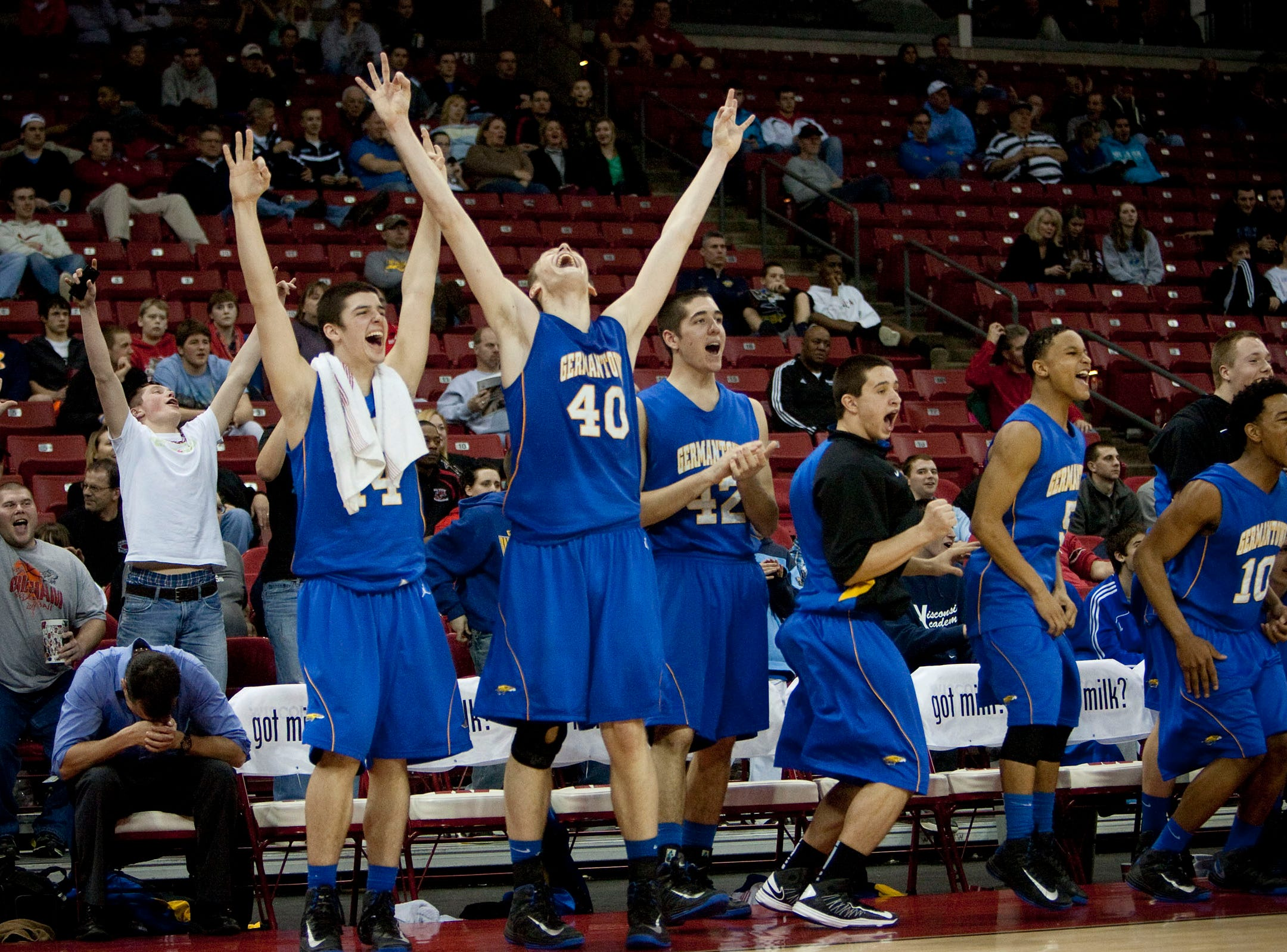 The Germantown bench including Luke Fischer (40) react as Germantown scores over Mukwonago in the closing seconds of the teams W.I.A.A. Division 1 Boys State Basketball Tournament Championship game in the Kohl Center Saturday, March 9, 2013.