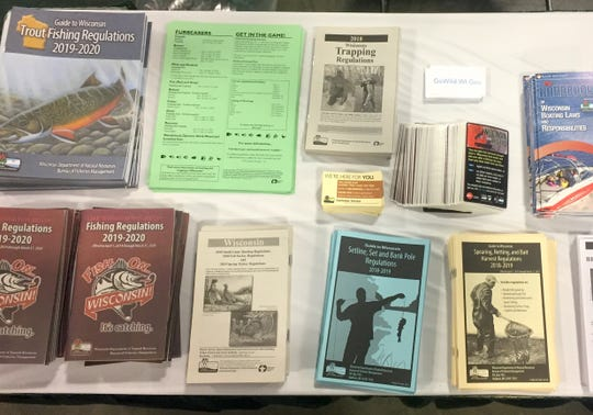 Regulations pamphlets and other literature  is offered at the Department of Natural Resources exhibit at the Milwaukee Journal Sentinel Sports Show.