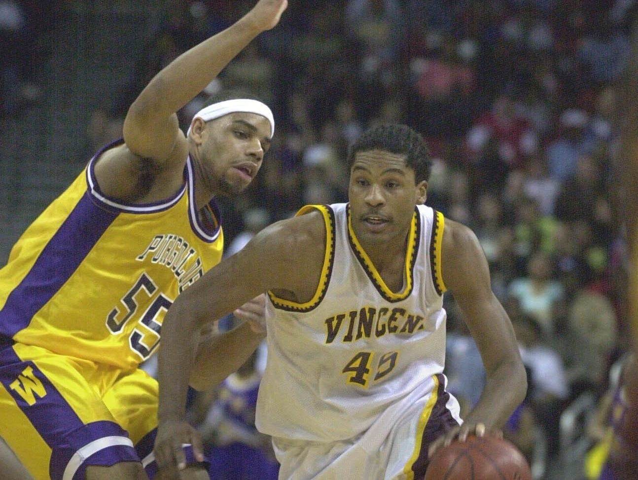 Vincent (45) Quemont Greer charges around Washington (55) Kamarr Davis to win the Division 1 WIAA State Boys Basketball championship title at the Kohl Center, Madison, Saturday, March 18, 2000.