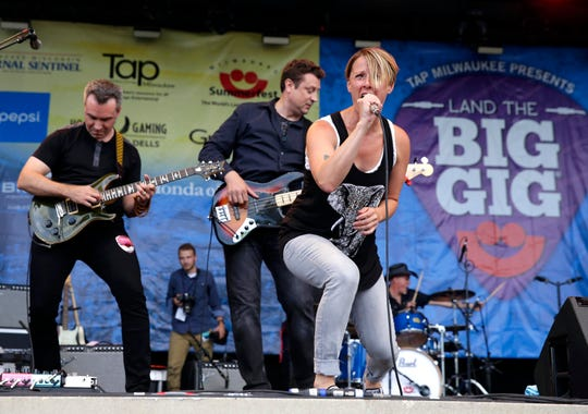"""Betsy Ade, singer and songwriter for Milwaukee-area alt-rock band Well-Known Strangers, performs at the Land the Big Gig competition at Summerfest in 2016. Strangers took second place. Ade is now competing on the 16th season of NBC's """"The Voice"""" as part of John Legend's team."""