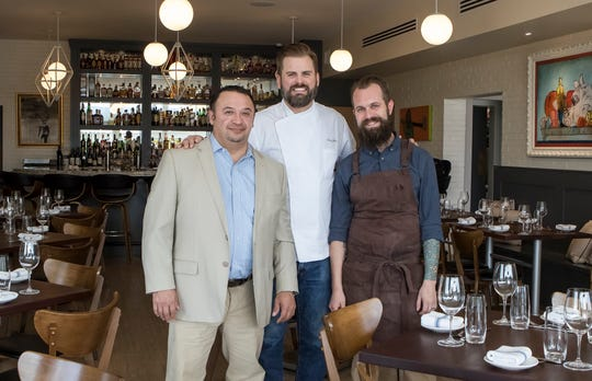 Mario Plaza, general manager and sommalier, left, Cory Bahr, owner and executive chef, and Justin Componation, chef de cuisine, pose for a portrait in Parish Restaurant and Bar in Monroe, La. on March 6. Componatiaon and Plaza are recent additions to Monroe and the restaurant to help build Parish as a neighborhood restaurant.