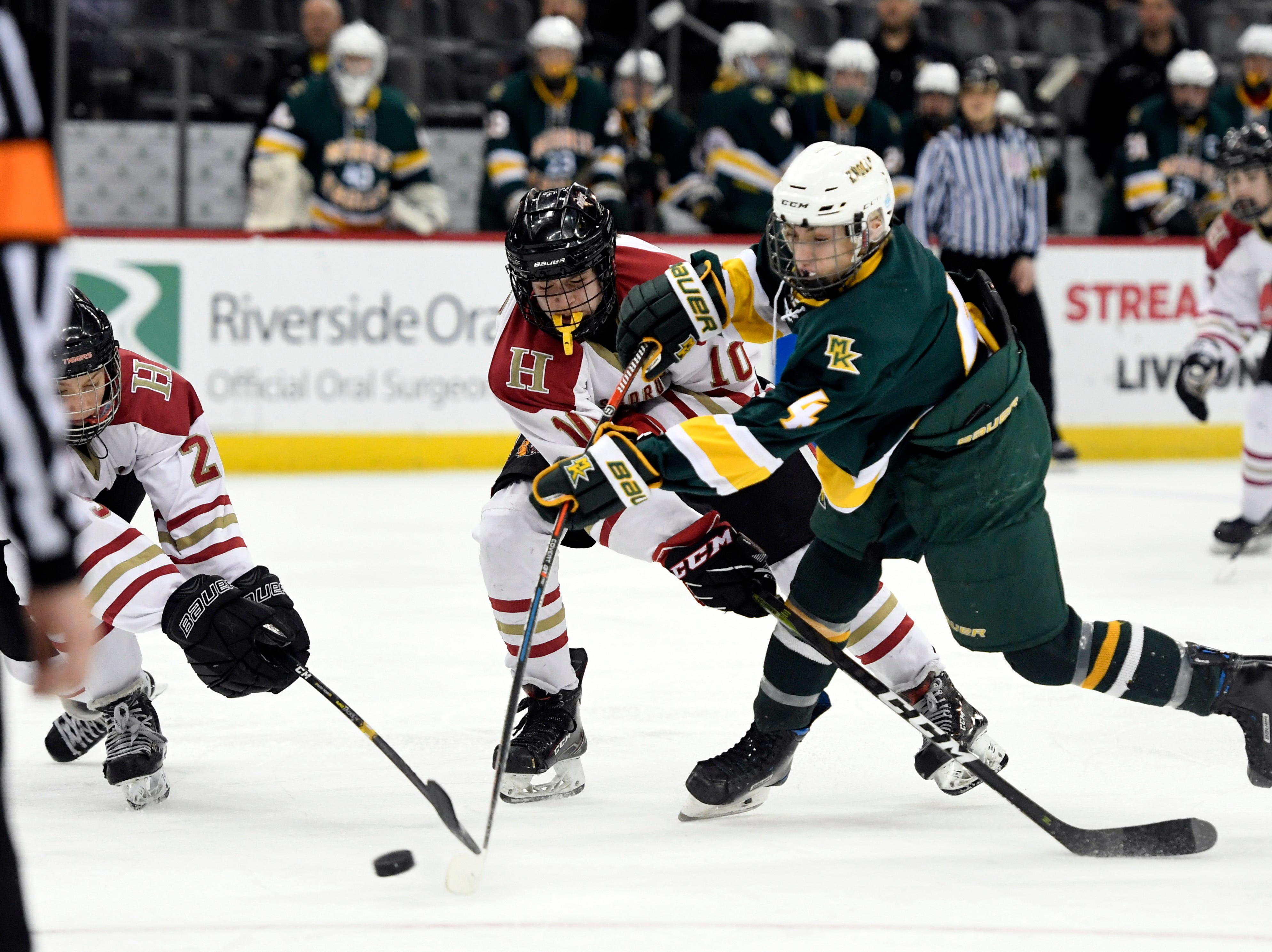 Morris Knolls/Hills' Gehrig Eckoff (4) scores the third goal of the game against Hillsborough in the second period in the Public A ice hockey final at the Prudential Center on Monday, March 4, 2019, in Newark.