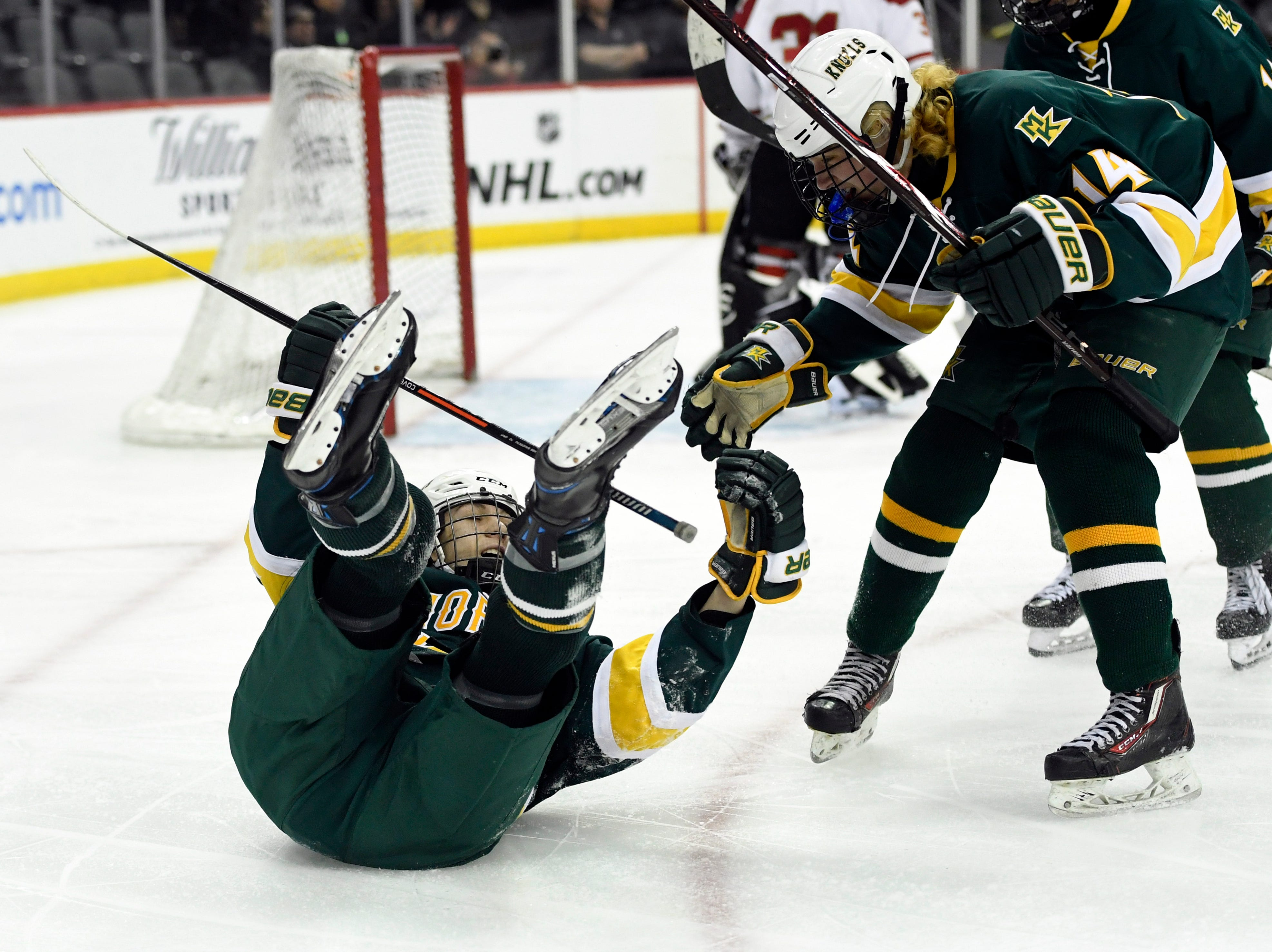 Morris Knolls/Hills' Gehrig Eckoff, left, and Sean Murray celebrate Walsh's goal in the second period in the Public A ice hockey final at the Prudential Center on Monday, March 4, 2019, in Newark.