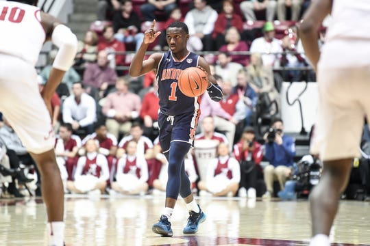 Auburn point guard jared Harper dribbles the ball up the court during Auburn's win over Alabama on March 5, 2019, in Tuscaloosa, Ala.