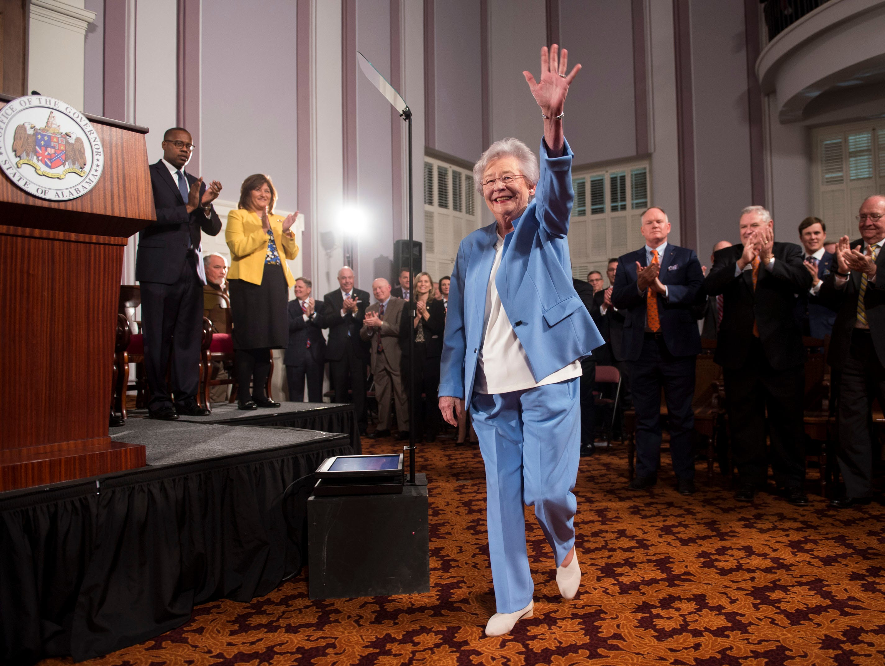Gov. Kay Ivey enters the room before she delivers the State of the State address inside the old house chambers at the Alabama State Capitol in Montgomery, Ala., on Tuesday, March 5, 2019.