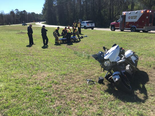 A PPD motor officer received minor injuries in a Wednesday morning wreck.