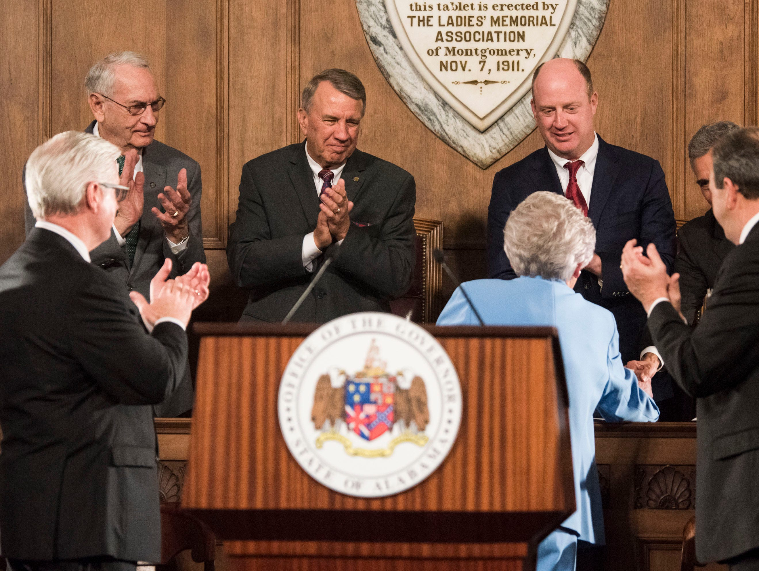 Gov. Kay Ivey shakes hands with state leaders before delivering the State of the State address inside the old house chambers at the Alabama State Capitol in Montgomery, Ala., on Tuesday, March 5, 2019.