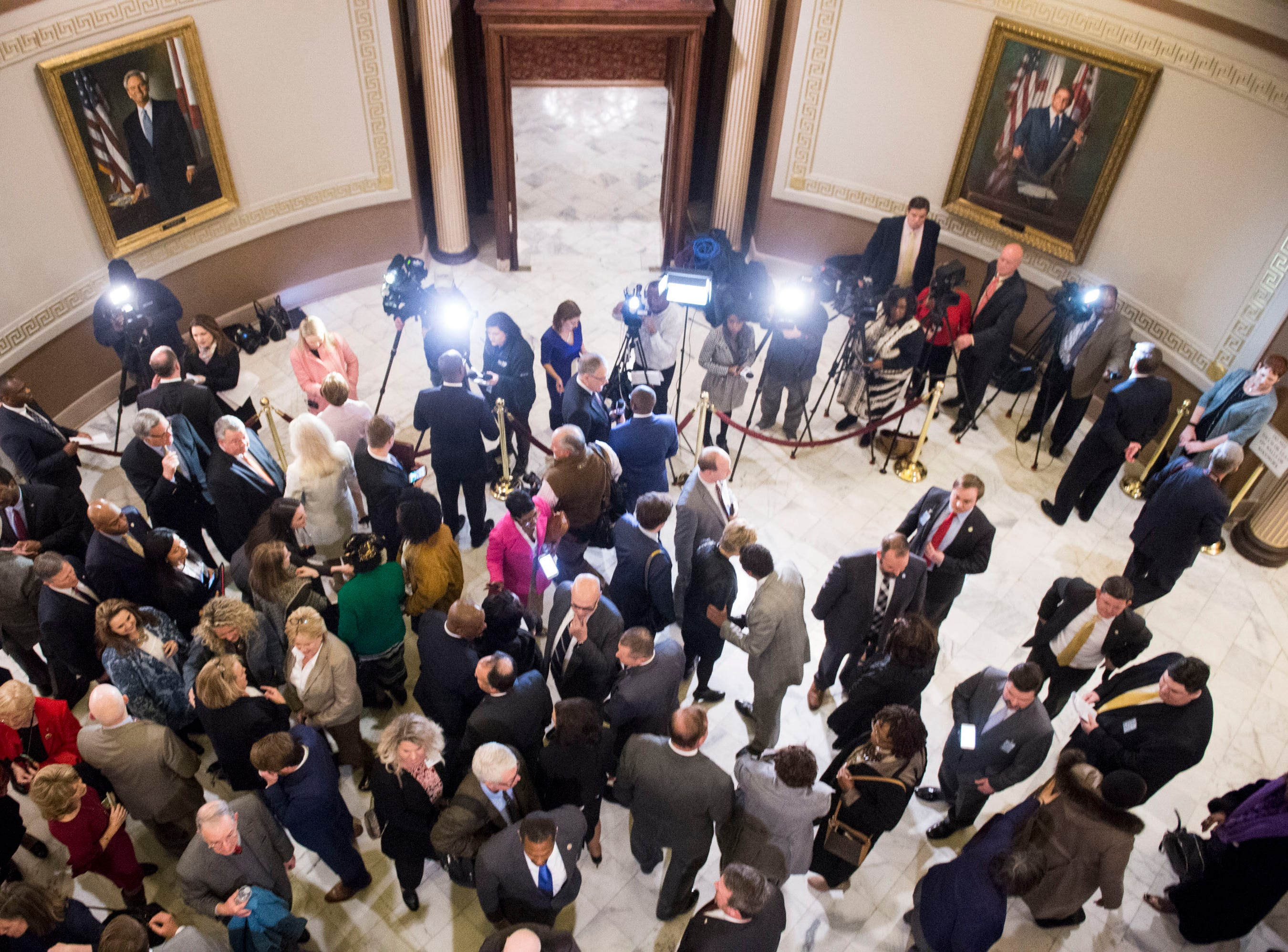 Media interviews legislatures and other officials after the State of the State address inside the old house chambers at the Alabama State Capitol in Montgomery, Ala., on Tuesday, March 5, 2019.