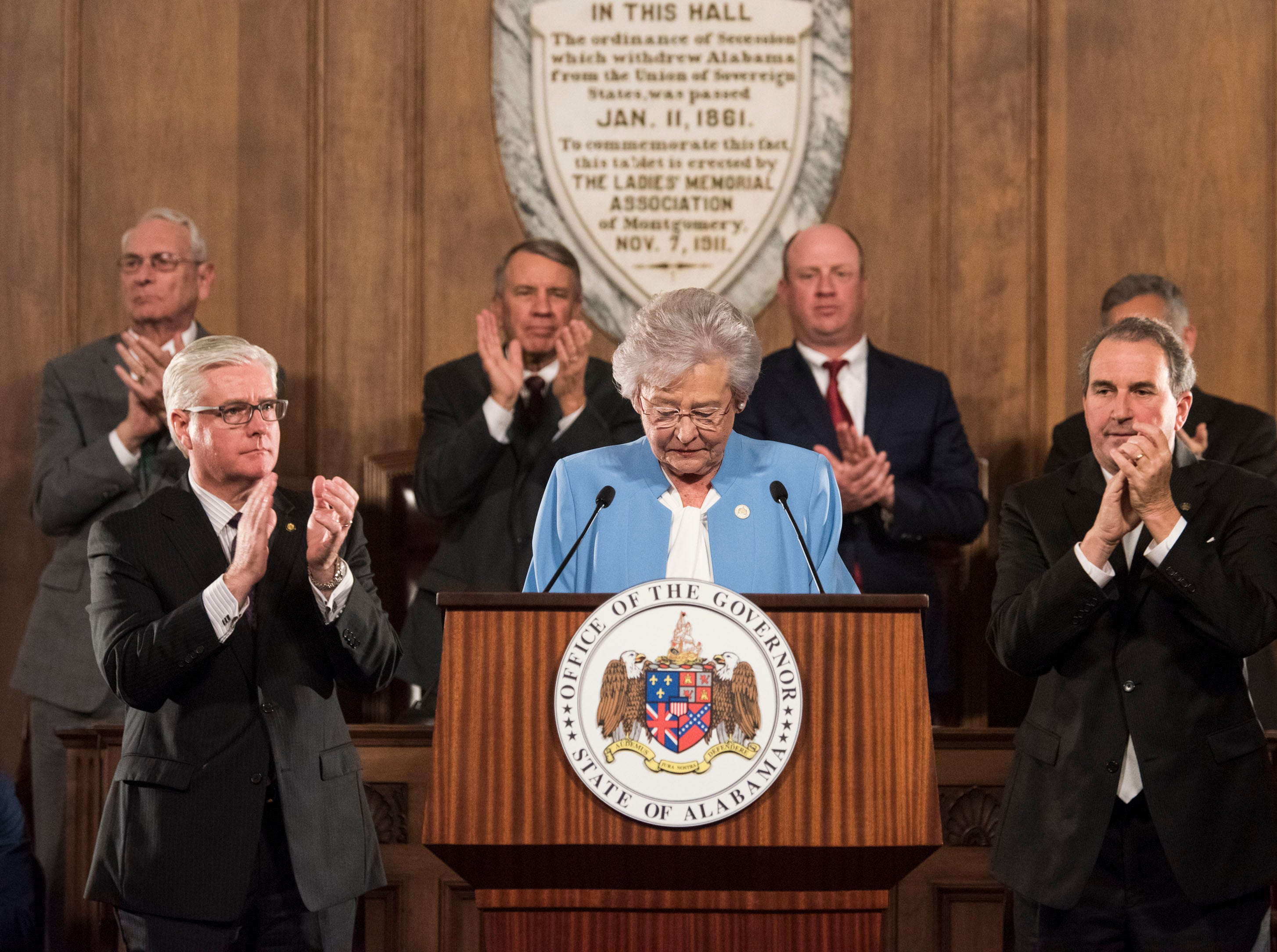 Gov. Kay Ivey revives applause as she delivers the State of the State address inside the old house chambers at the Alabama State Capitol in Montgomery, Ala., on Tuesday, March 5, 2019.