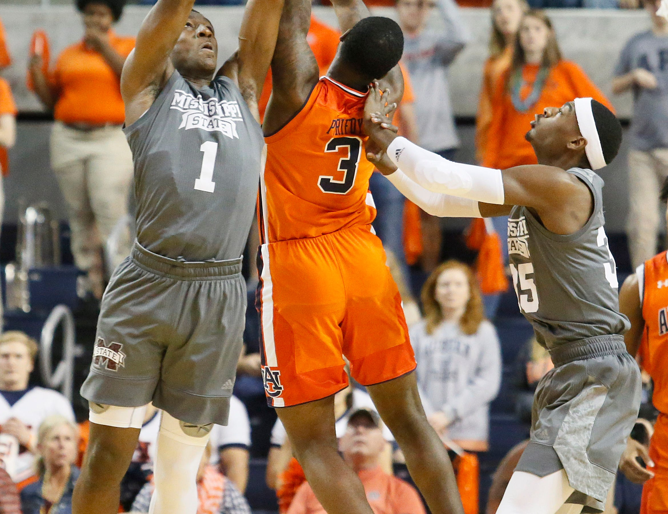 Mar 2, 2019; Auburn, AL, USA; Mississippi State Bulldogs forward Reggie Perry (1) and forward Aric Holman (35) battle for a rebound with Auburn Tigers forward Danjel Purifoy (3) during the first half at Auburn Arena. Mandatory Credit: John Reed-USA TODAY Sports